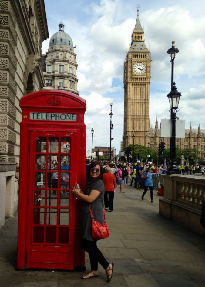 Maciejewski posing in front of Big Ben, with a notorious, red phonebooth.